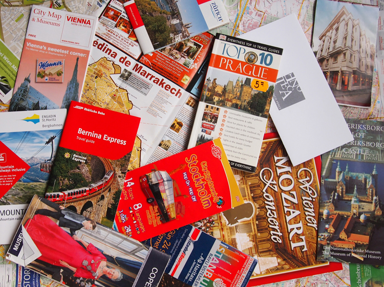 Maps, guides, brochures collected from trips