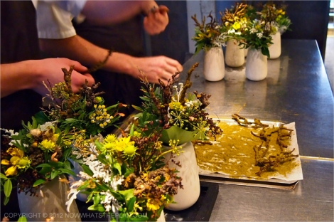 Flower vases and oven tray of twigs