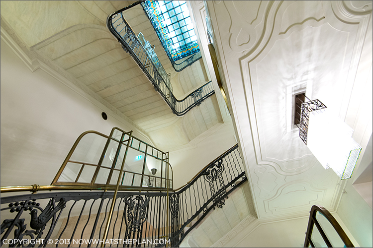 Beautiful stairwell topped with stained glass skylight windows