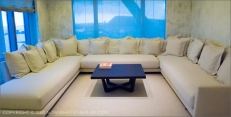 Hotel Arts Barcelona: The Arts Suite's magnificent sectional sofa - wrapping around the room like how the suite wraps around the seafront