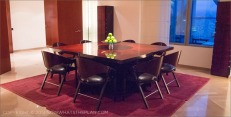 Hotel Arts Barcelona: Rich mahogany and burgundy for the Royal Suite's dining area