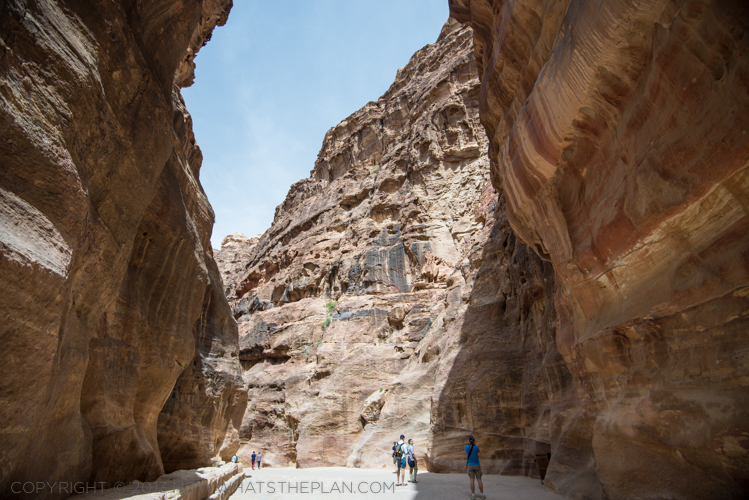 The Siq walled by sandstone cliffs
