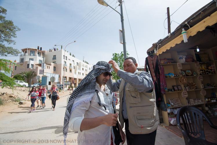 KD getting a bit of help in tying a Bedouin head scarf