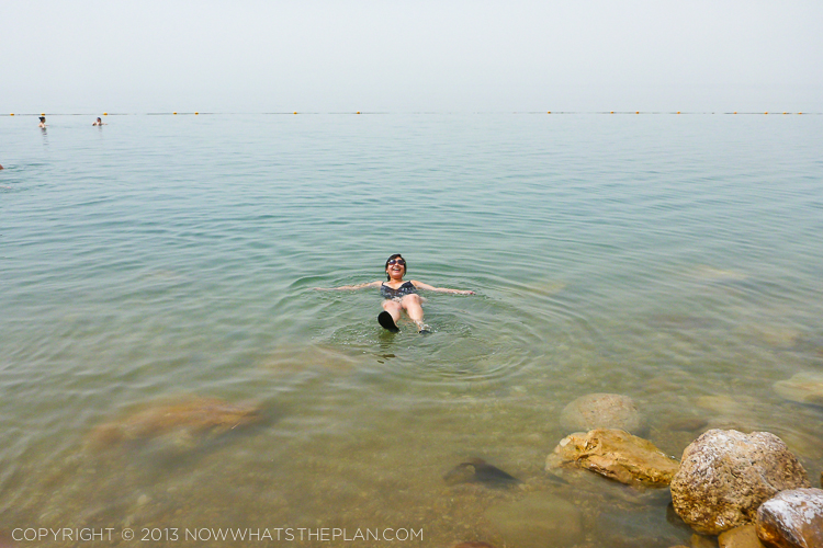 Laughing and loving the experience of effortlessly floating in the Dead Sea