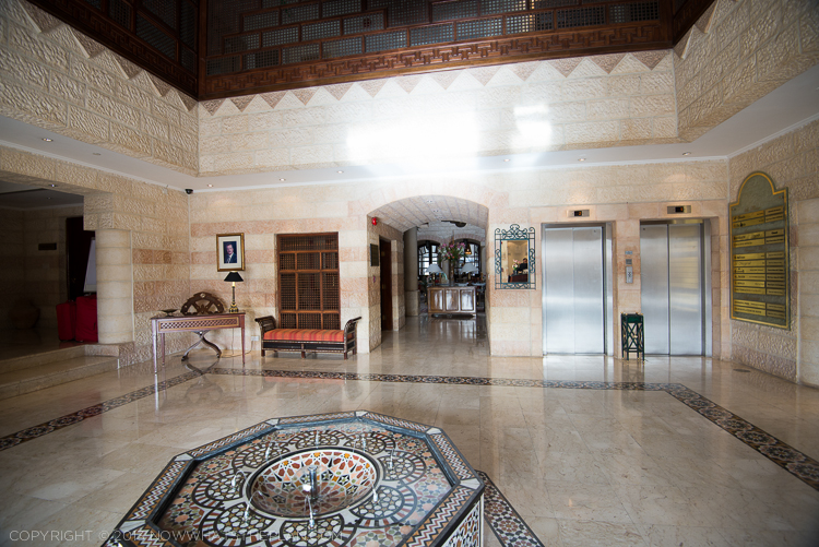 Movenpick Resort Petra's lobby boasts of walls of natural stone, marble on the floor, and accents of handcrafted wood and mosaics