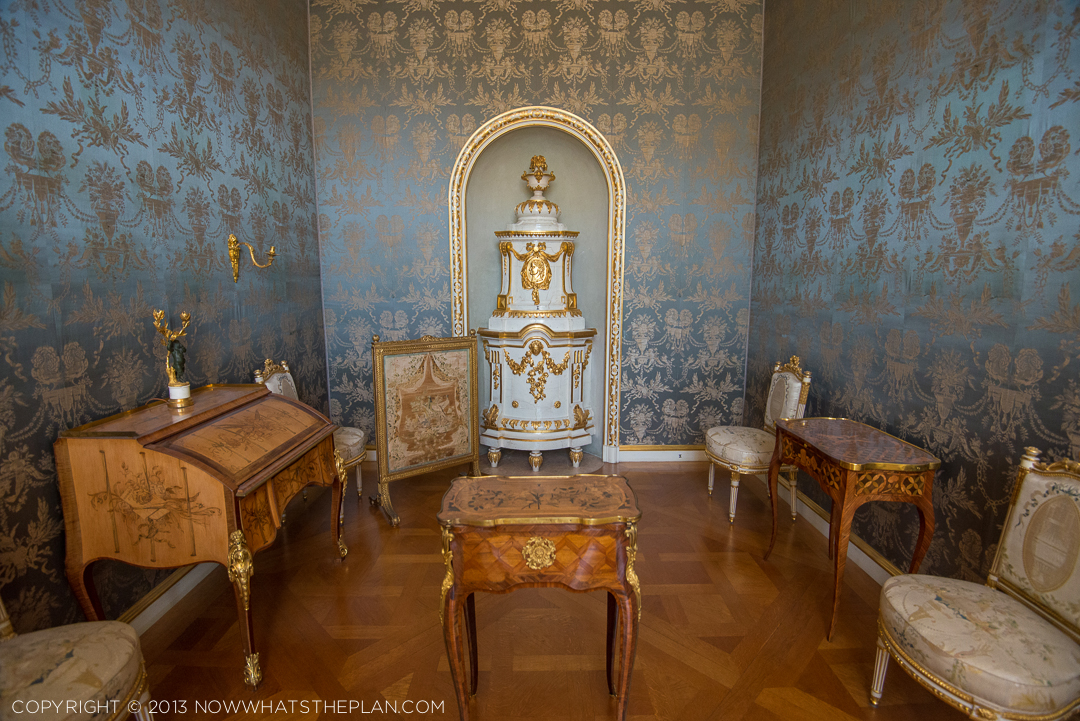 Silk damask walls of powder blue and gold