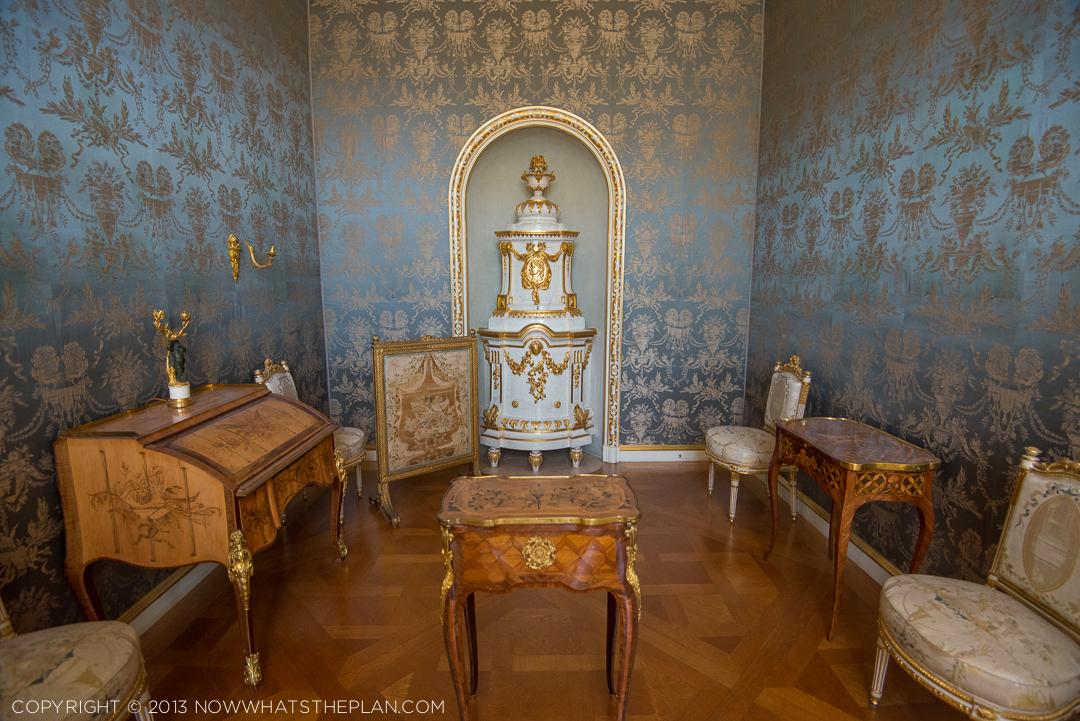 Silk damask walls of powder blue and gold